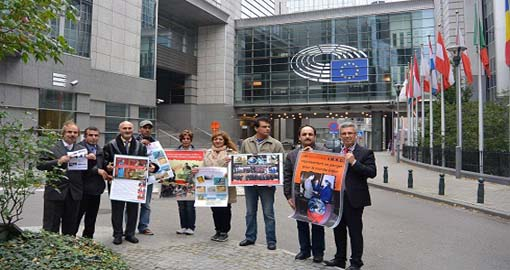 Human Rights activists rally in front of the EU Parliament to denounce the MKO