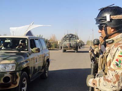 القوات العراقيه حمايه اشرف