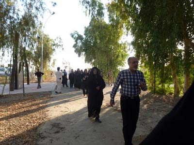Families and former MEK members arriving at the cemetery led by Mr Hassan Azizi