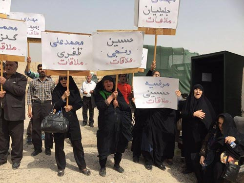 Families of MKO Cult hostages picketing in front of Camp Liberty