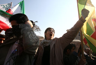 Iranians shout slogans in front of the British Embassy in Tehran.